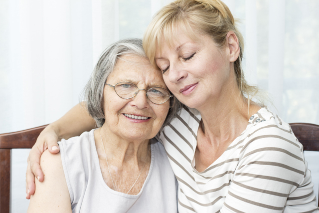 Elderly woman and daughter Resized