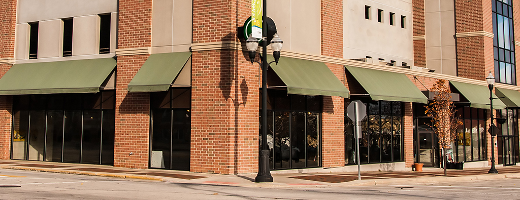 Commercial Realty Services brick storefront on street