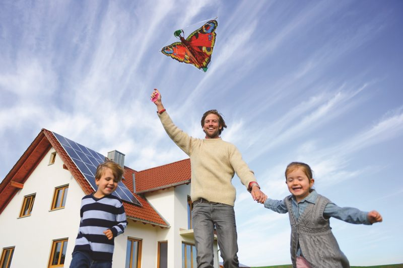family with kite solar panel on roof
