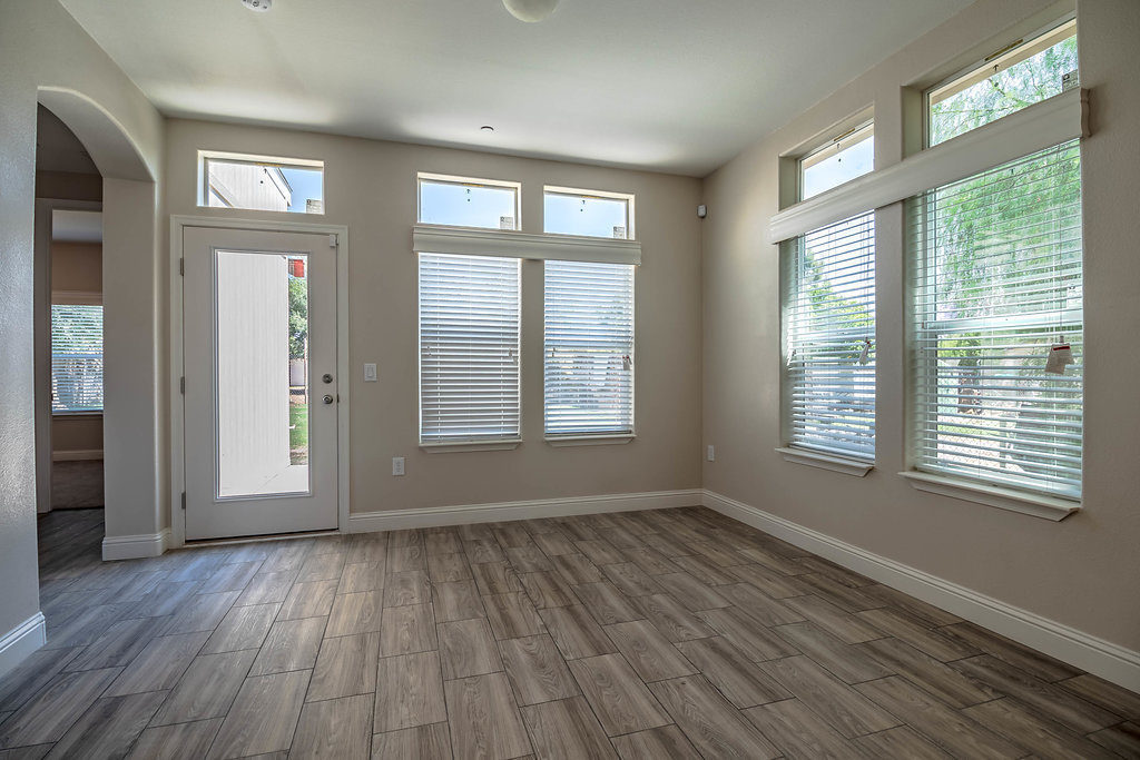 Photo of front living room space and front door access with open blinds