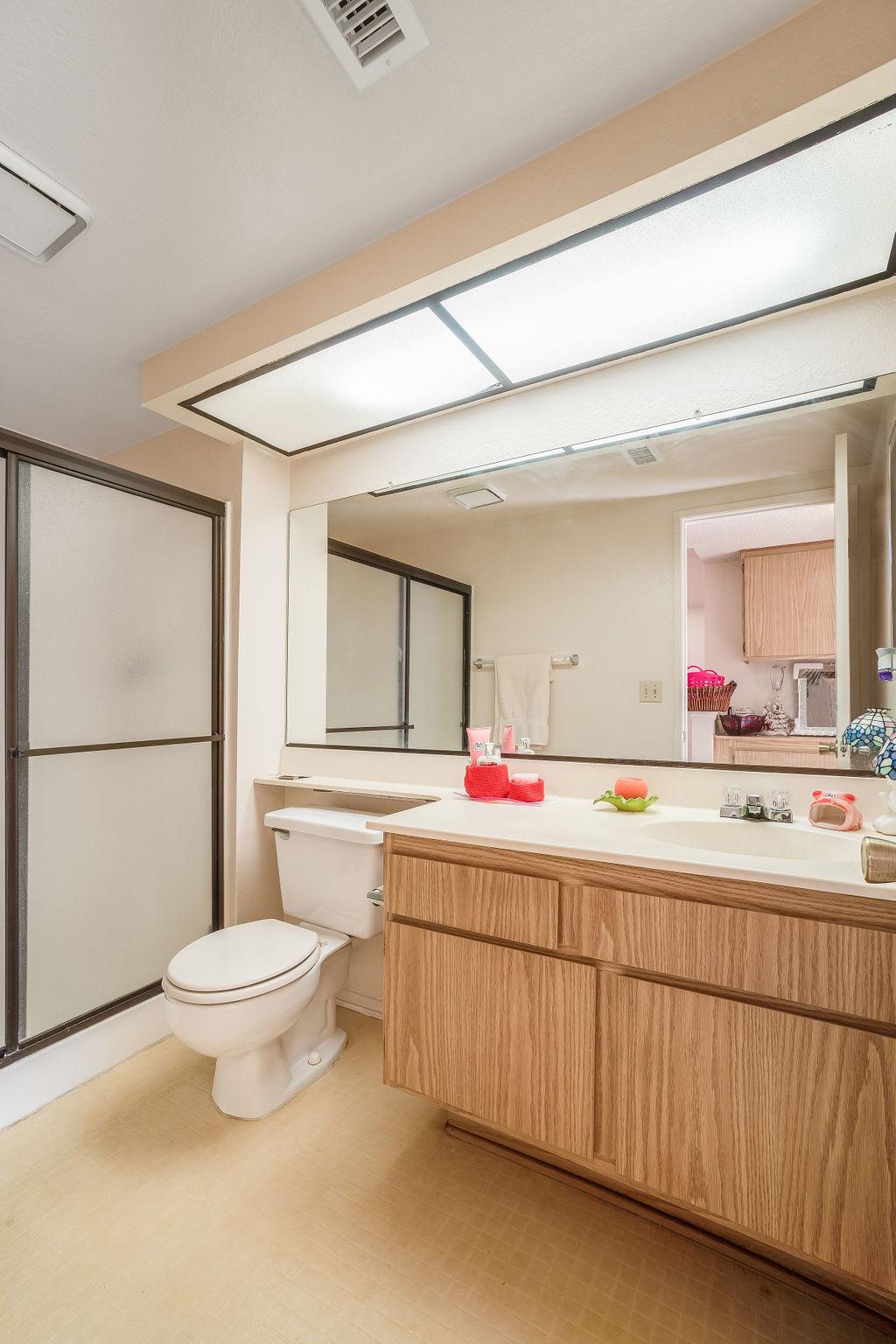 La Jolla Dr. property interior photo of bathroom and mirror